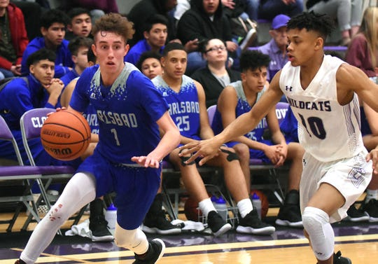 Carlsbad guard Josh Sillas drives the baseline against Clovis defender Jacob Moon in the second half of Tuesday's District 4-5A game at Rock Staubus Gymnasium in Clovis. Sillas had 30 points and hit six 3-pointers in the 52-48 loss to Clovis.