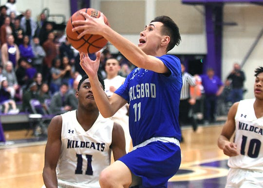 Carlsbad's Matt Fernandez attempts a driving layup in the second half of Tuesday's District 4-5A game at Rock Staubus Gymansium.