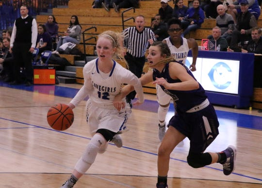 Carsyn Boswell drives to the lane during Tuesday's game against Clovis. She finished with 15 points.