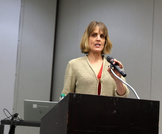University of New Mexico economist Kelly O'Donnell discusses replacing the San Juan Generating Station with a solar field during a meeting Monday at San Juan College in Farmington.