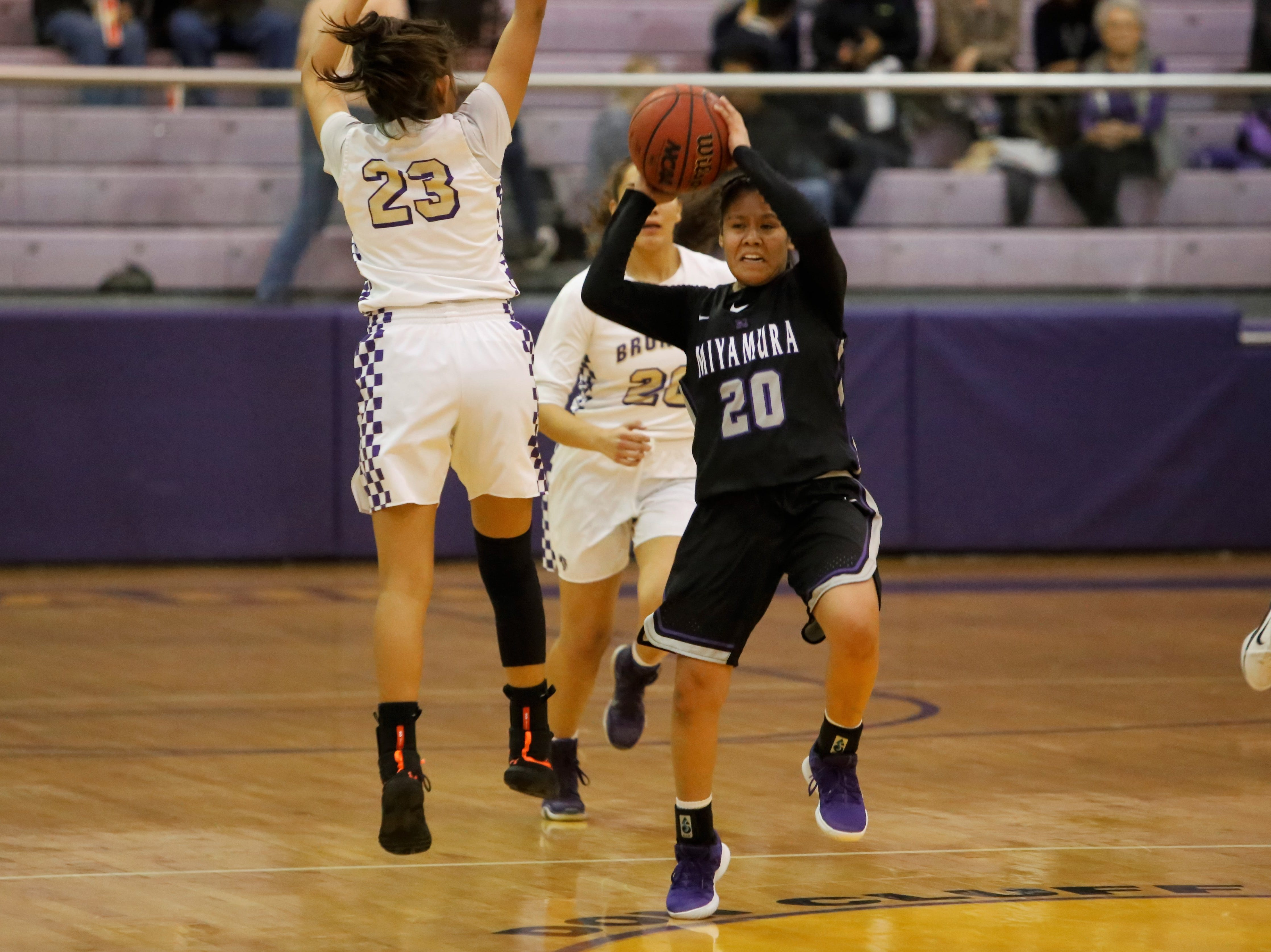 Miyamura's Noelle Charleston throws an outlet pass down the right side against Kirtland Central during Tuesday's District 1-4A game at Bronco Arena in Kirtland.