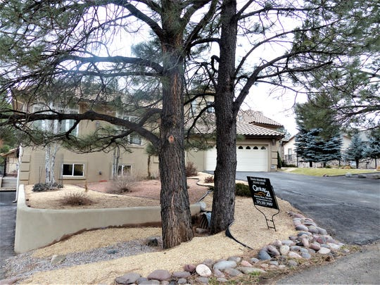 One of the properties for sale in the village of Ruidoso backs up to a golf course.