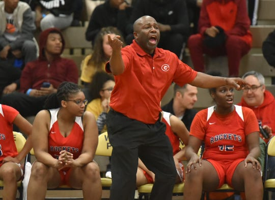 Westland John Glenn coach Derrick Jordan shouts instructions to his team during their Jan. 29 game at Wayne Memorial.