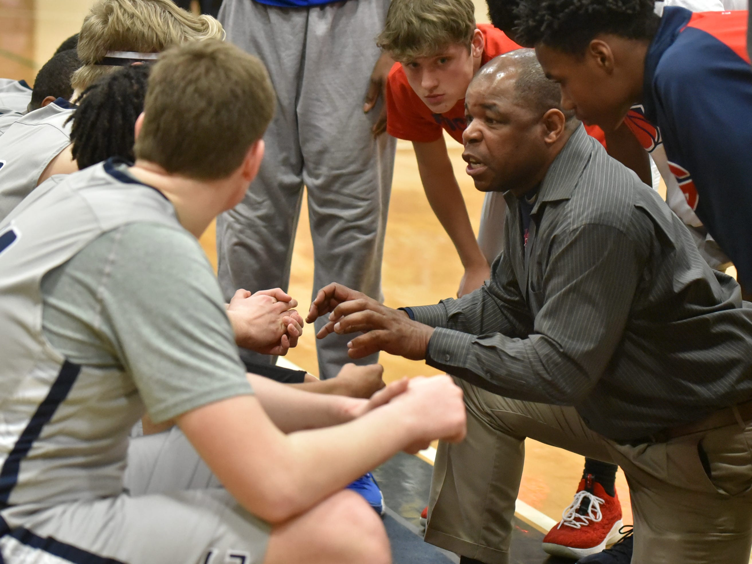 John Glenn's head coach talks to his troops during a timeout.