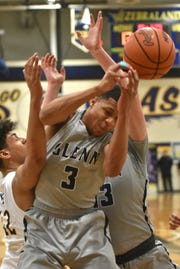 Glenn's Joe Moon gets sandwiched while trying to gather in a rebound.