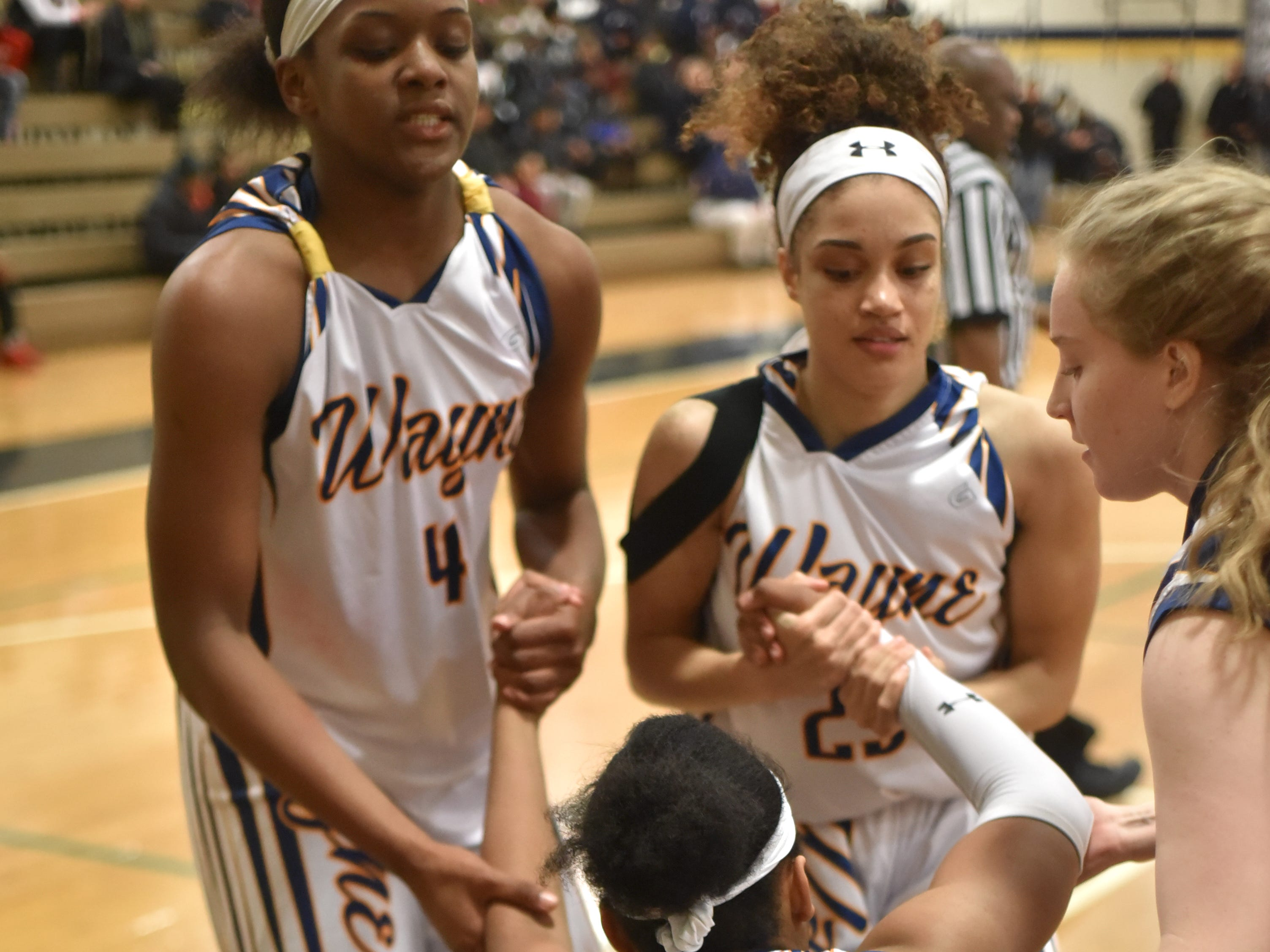 Jeanae Terry's teammates pick her up off the floor.