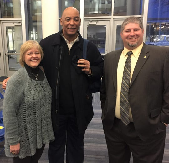 New Madonna University football coach Brian Foos (right) made his formal introduction and is greeted by NFL Hall of Famer Kellen Winslow and his mother Gail.