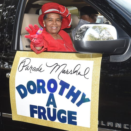 Parade Marshal Dorothy A. Fruge waves to the crowd as she leads the annual Dr. Martin Luther King, Jr. Parade through the streets of Opelousas.