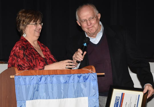 Dr. Joe Wilson receives the Board Member of the Year award from Ginger LeCompte at Tuesday's St.Landry-Evangeline United Way banquet held at the Delta Grand in Opelousas. Steven Morrow also received a Board Member award, but was not present at the event.