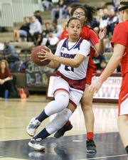 Chloe Minor drives the ball in side for La Quinta against Palm Desert on Tuesday.