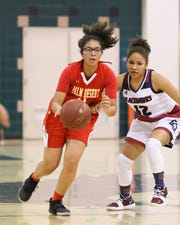 Palm Desert's Fabiana Langston dribbles the ball up court against La Quinta on Tuesday.