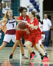 The swarming La Quinta defense made it difficult on Palm Desert star Alexis Legan (13) on Tuesday night.