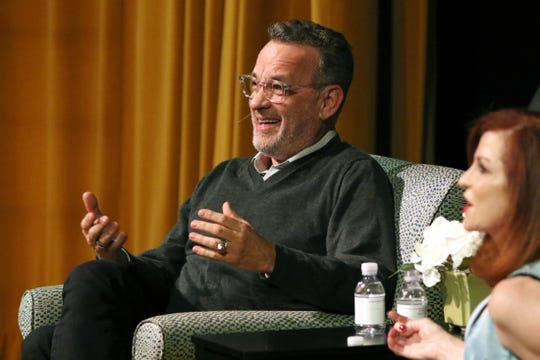 Tom Hanks shares a laugh with Maureen Dowd during the Rancho Mirage Writers Festival opening event Tuesday at the Annenberg Center in Rancho Mirage.