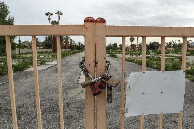 The gates are locked at the defunct Rancho Palms mobile home community in Rancho Mirage, January 30, 2019.