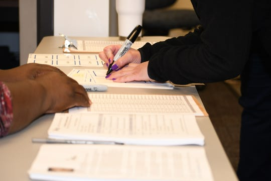 """Attendees of the Pensacola Habitat for Humanity """"New Year, YOU Lead"""" workshop Jan. 24, 2019, write out their leadership goals. The """"2019 Connected Communities"""" series helps cities take ownership of their neighborhoods."""