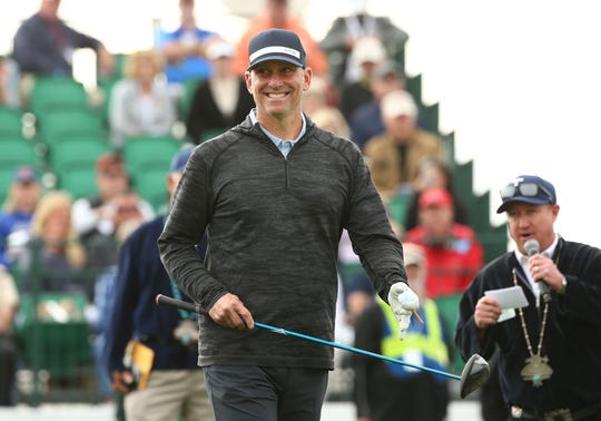 Arizona Diamondbacks manager Torey Lovullo smiles as he steps up to hit his drive on the first hole during the Annexus Pro-Am on Jan. 30 at the TPC Scottsdale Stadium Course.