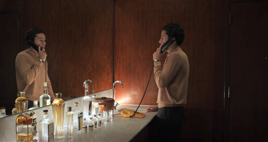 "Reed (Christopher Abbott) makes a call in ""Piercing."""