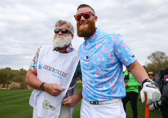 Diamondbacks pitcher Archie Bradley and his father Charles, who caddied for him at the Waste Management Phoenix Open Annexus Pro-Am, pose for a photograph on the TPC Scottsdale Stadium Course.