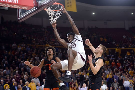 Arizona State Sun Devils forward Zylan Cheatham (45) dunks over Oregon State Beavers guard Ethan Thompson (5) and forward Tres Tinkle (3) and  during the second half at Wells Fargo Arena Jan. 17. Joe Camporeale-USA TODAY Sports