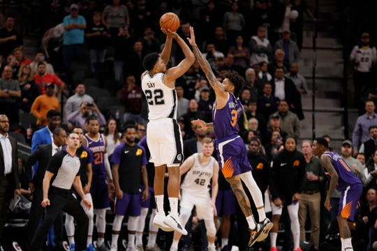 Jan 29, 2019: San Antonio Spurs small forward Rudy Gay (22) shoots the ball over Phoenix Suns small forward Kelly Oubre Jr. (3) at the buzzer during the second half at AT&T Center.