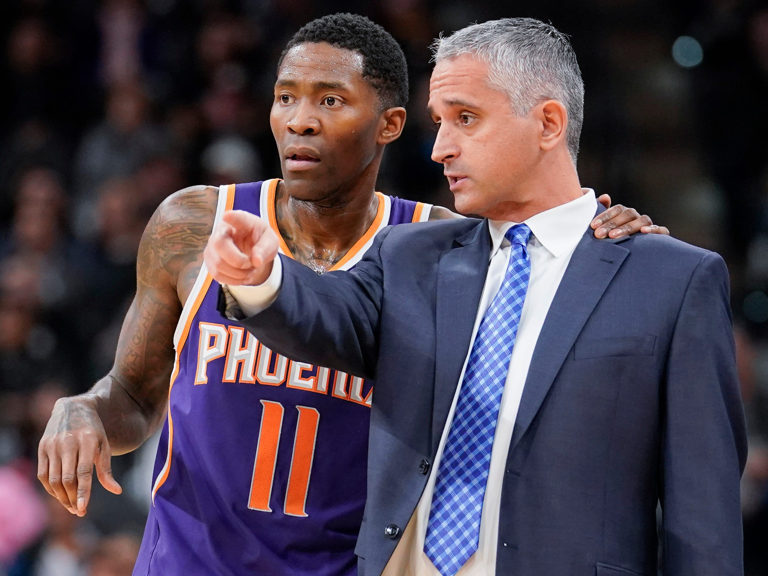 Phoenix Suns head coach Igor Kokoskov, right, talks with Suns guard Jamal Crawford during a timeout in the first half of an NBA basketball game against the San Antonio Spurs, Tuesday, Jan. 29, 2019, in San Antonio. (AP Photo/Darren Abate)