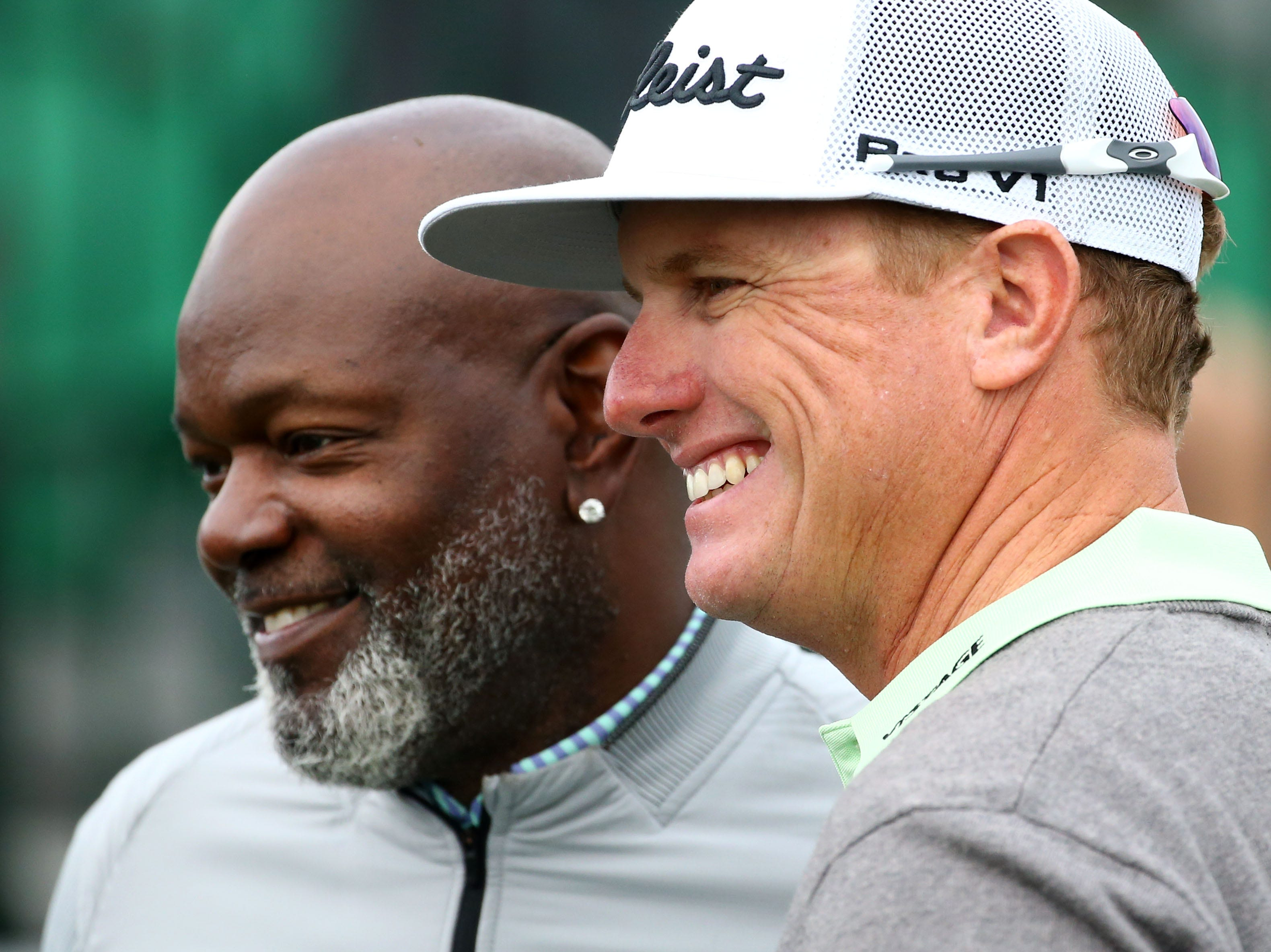 Charley Hoffman and Emmitt Smith pose on the first tee during the Annexus Pro-Am on Jan. 30 at the TPC Scottsdale Stadium Course.