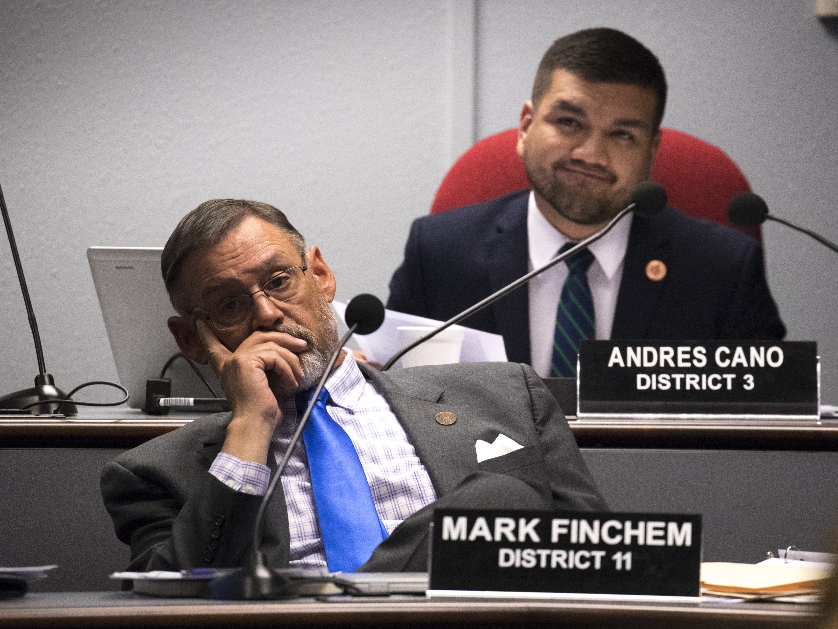 Rep. Mark Finchem (front) and Rep. Andres Cano listen during a hearing on HB 2540, Jan. 29, 2019, at the Arizona House of Representatives' Committee on Natural Resources, Energy and Water at the Arizona Capitol.