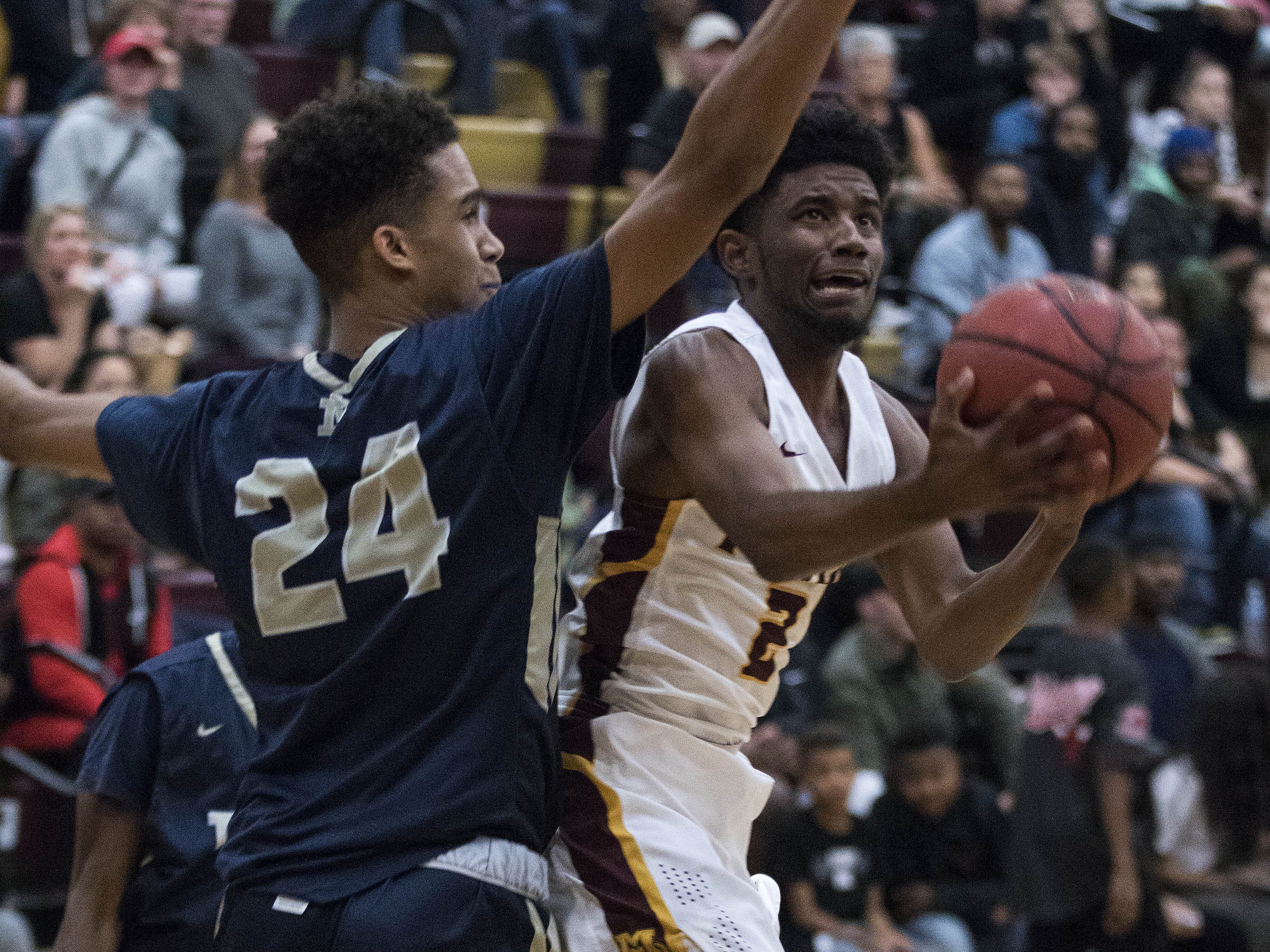 Mountain Pointe's Khalid Price (2) drives against Desert Vista's Osasere Ighodaro (24) during their game in Phoenix on Tuesday, Jan. 29.