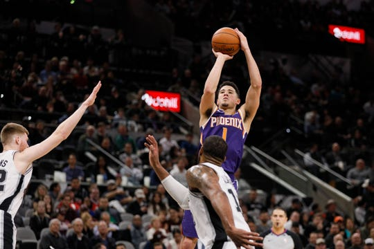 Jan 29, 2019: Phoenix Suns shooting guard Devin Booker (1) shoots the ball over San Antonio Spurs power forward LaMarcus Aldridge (12) during the second half at AT&T Center.