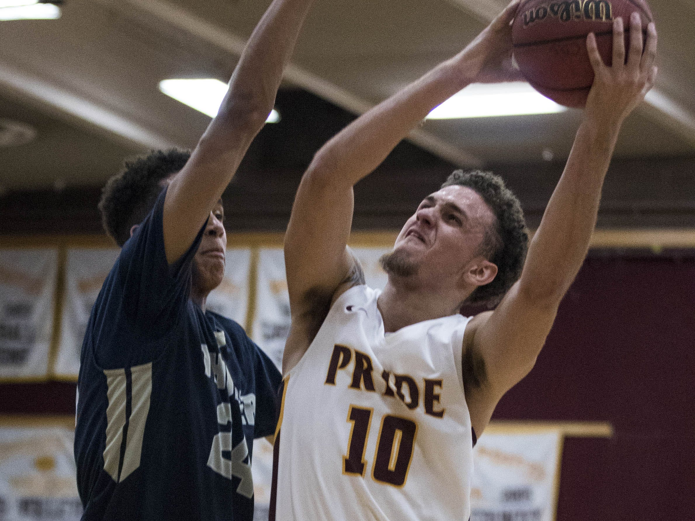 Mountain Pointe's Jonah LaBranche (10) looks to shoot  against Desert Vista's Osasere Ighodaro (24) during their game in Phoenix on Tuesday, Jan. 29.