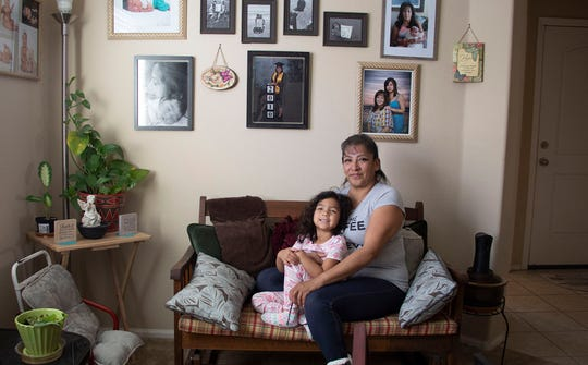 Alicia Perez sits with her granddaughter in her Tolleson home on Jan. 25, 2019. She received housing counseling to avoid foreclosure through ARC Arizona.