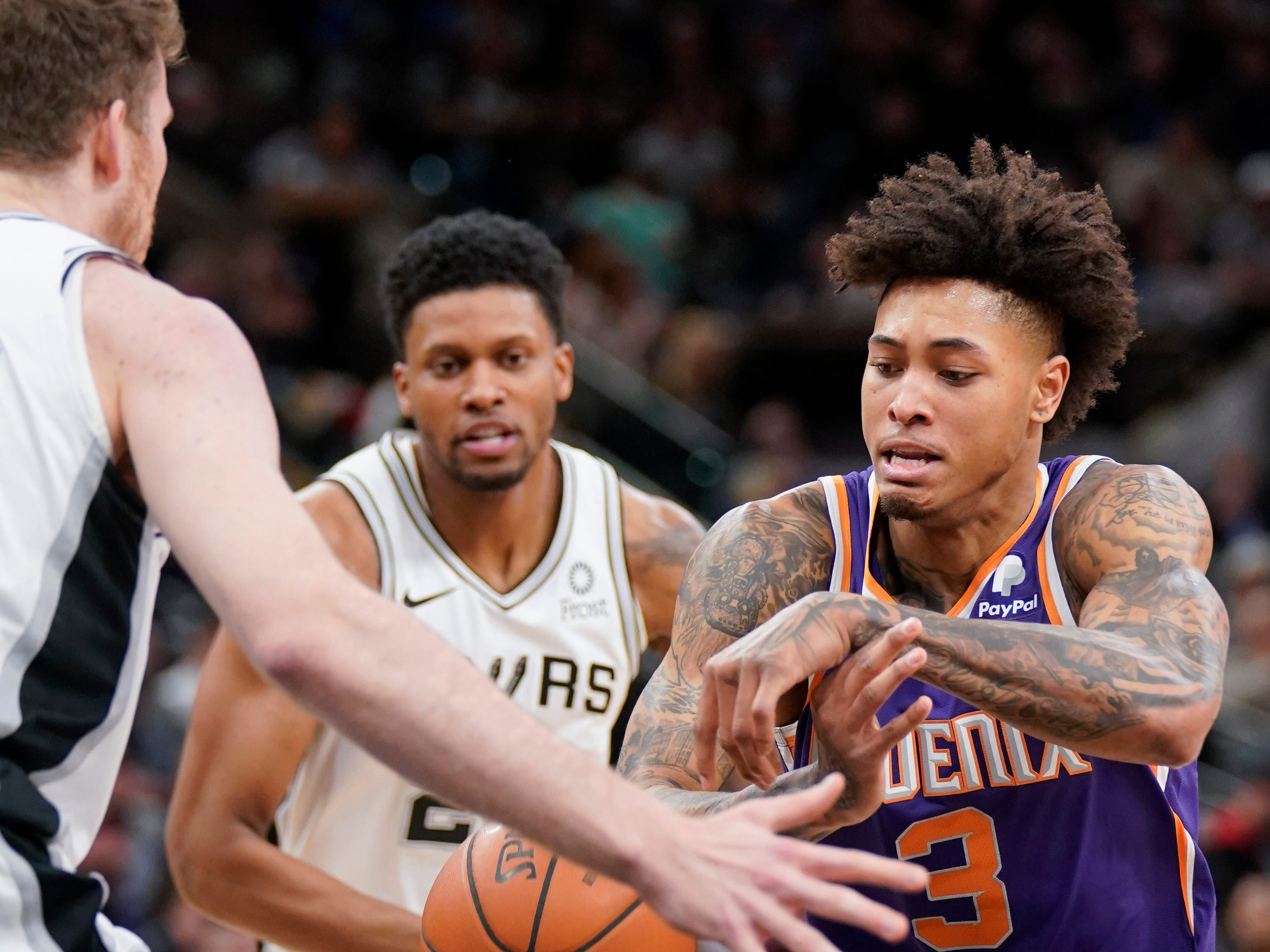 Phoenix Suns' Kelly Oubre, Jr. (3) loses the ball as he drives against San Antonio Spurs' Jakob Poeltl, left, and Rudy Gay during the first half of an NBA basketball game, Tuesday, Jan. 29, 2019, in San Antonio. (AP Photo/Darren Abate)