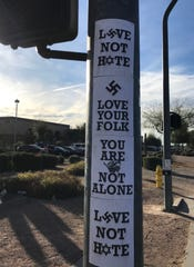 Several signs containing swastikas and the Star of David were posted near Skyline High School in Mesa Jan. 30, 2019.