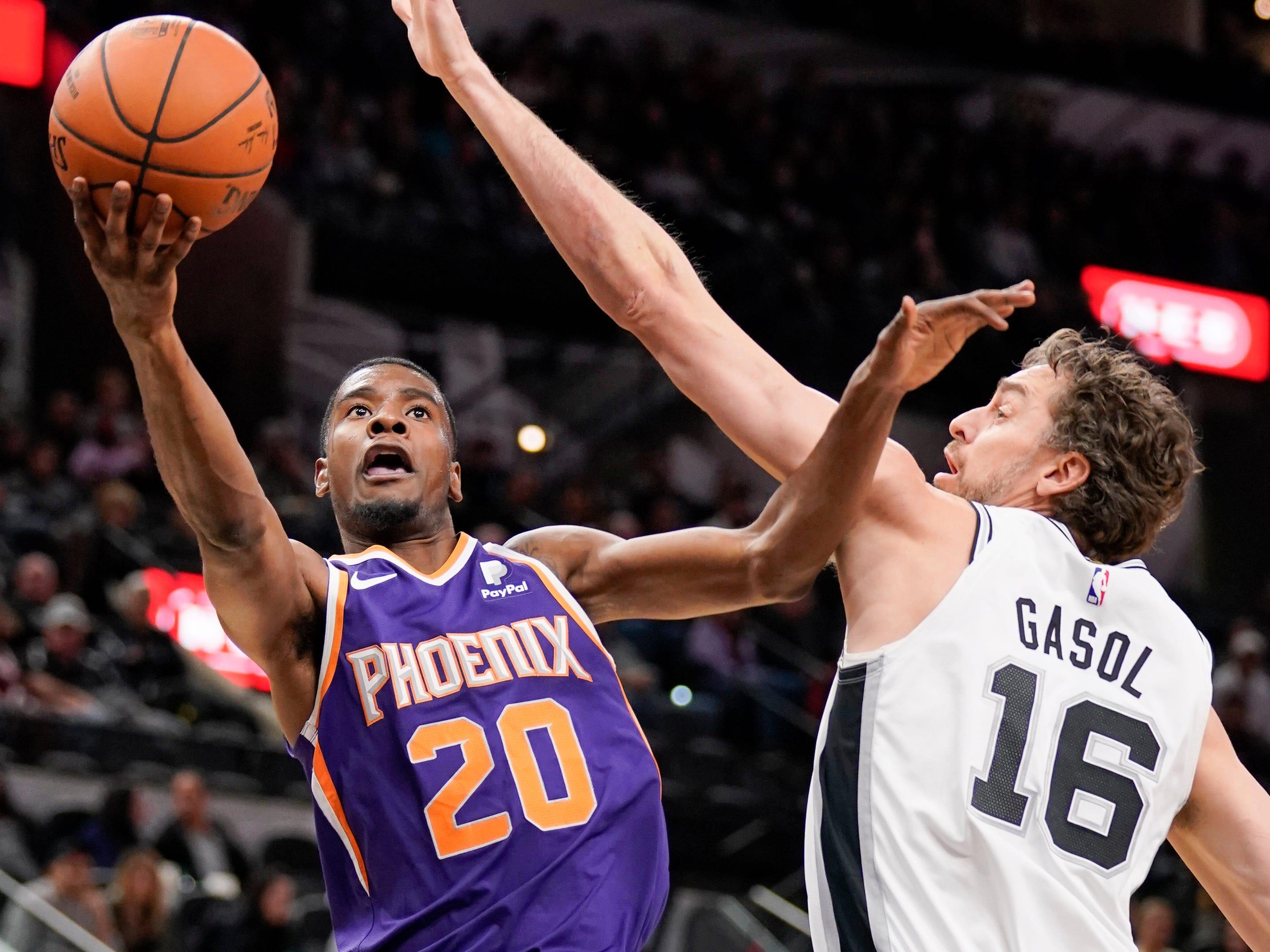 Phoenix Suns' Josh Jackson (20) shoots against San Antonio Spurs' Pau Gasol during the first half of an NBA basketball game, Tuesday, Jan. 29, 2019, in San Antonio.