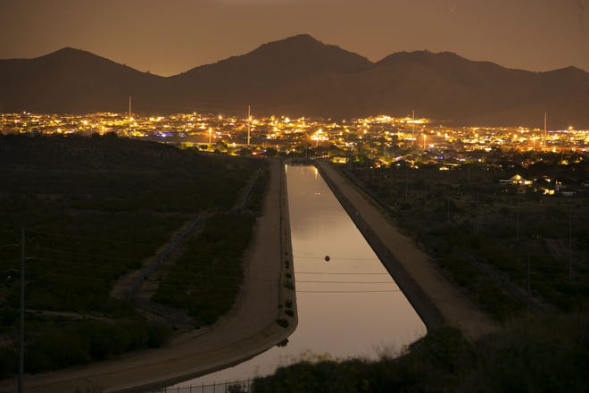 The CAP Canal heads toward a neighborhood in Phoenix as seen from the Deem Hills Recreation Area on Dec. 12, 2018.