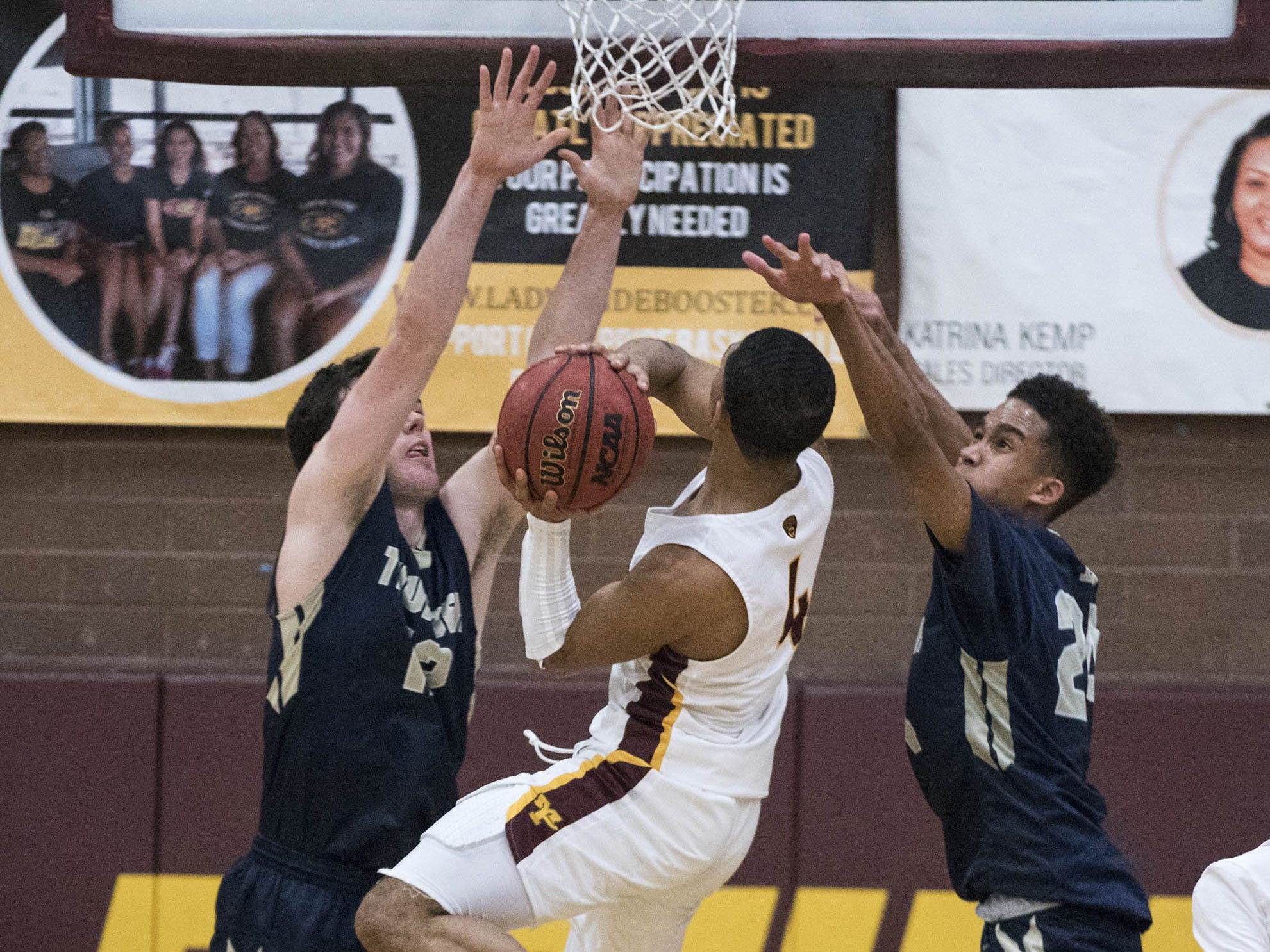 Desert Vista's Mason HarbertsonÊ(12) and Osasere Ighodaro (24) try to stop Mountain Pointe's Rashaan Toombs (4) during their game in Phoenix on Tuesday, Jan. 29.