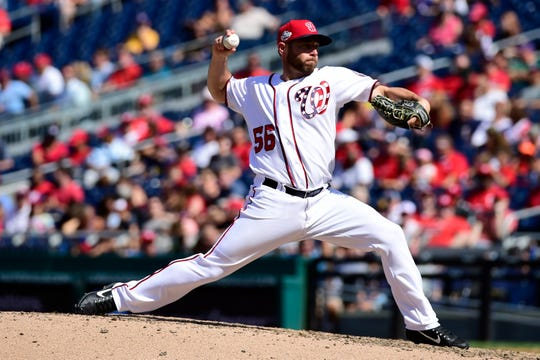Washington Nationals relief pitcher Greg Holland (56) pitches in the ninth inning against the Philadelphia Phillies at Nationals Park.
