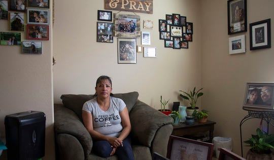 Alicia Perez, who received mortgage assistance through Save Our Home Arizona, sits in the front room of her Tolleson home on Jan. 25, 2019.