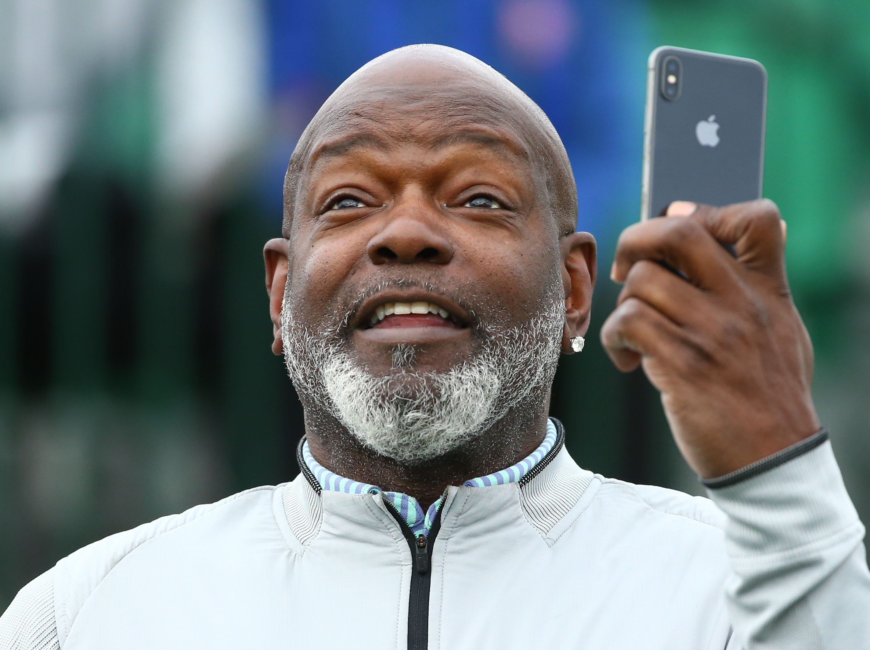 Retired NFL great Emmitt Smith makes a video on the first tee box during the Annexus Pro-Am on Jan. 30 at the TPC Scottsdale Stadium Course.
