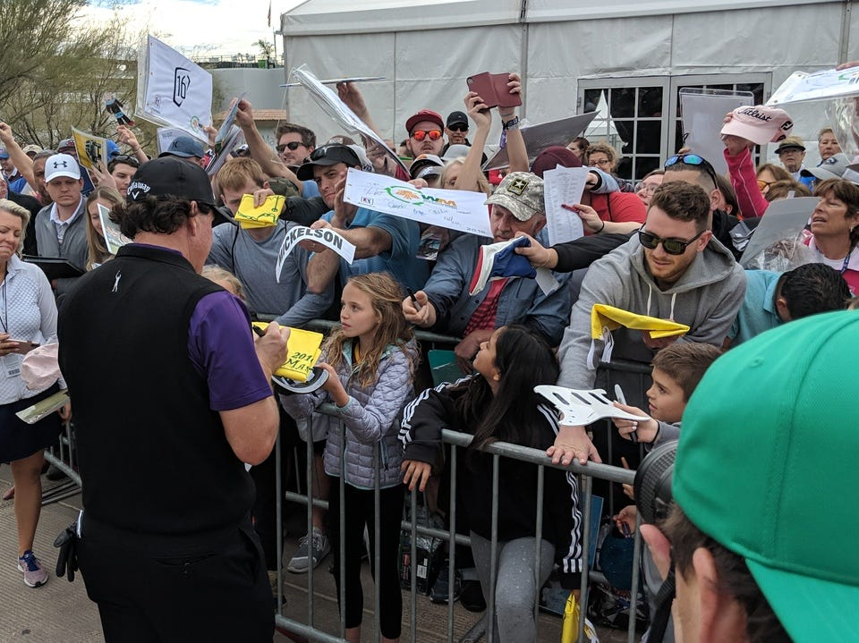 Phil Mickelson signs autographs for fans at Waste Management Phoenix Open following his pro-am round on Wednesday, Jan. 30, 2019.