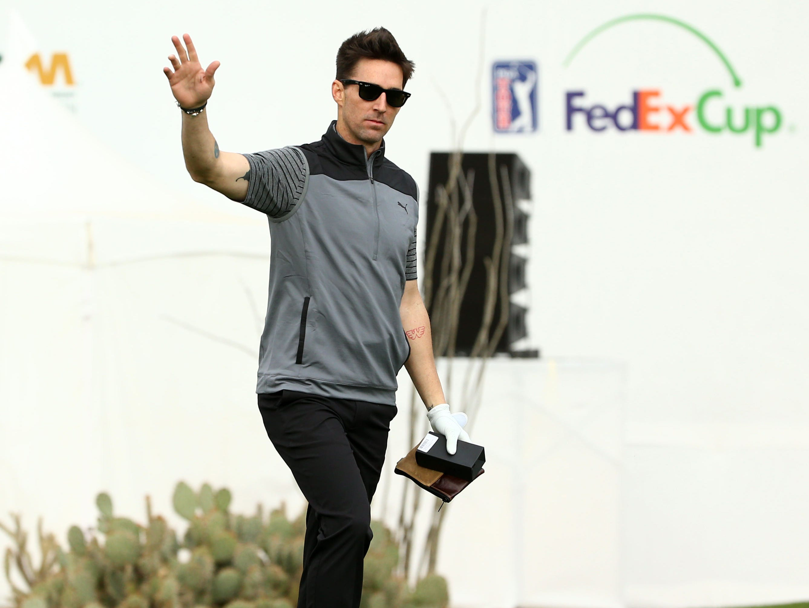 Country music singer Jake Owen waves to the gallery on the 16th hole during the Annexus Pro-Am on Jan. 30 at the TPC Scottsdale Stadium Course.