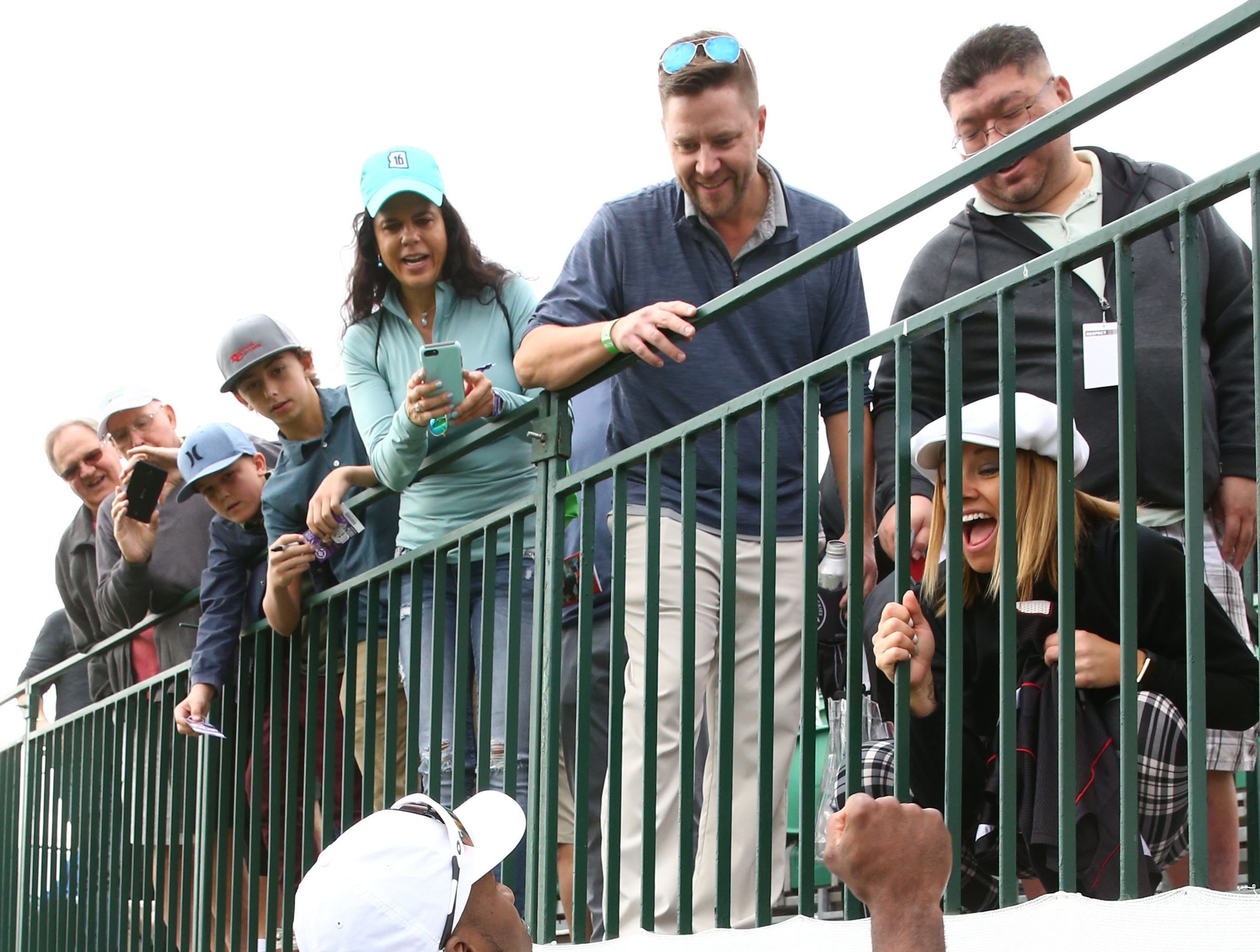 Arizona Cardinals cornerback Patrick Peterson greets a screaming fan during the Annexus Pro-Am on Jan. 30 at the TPC Scottsdale Stadium Course.