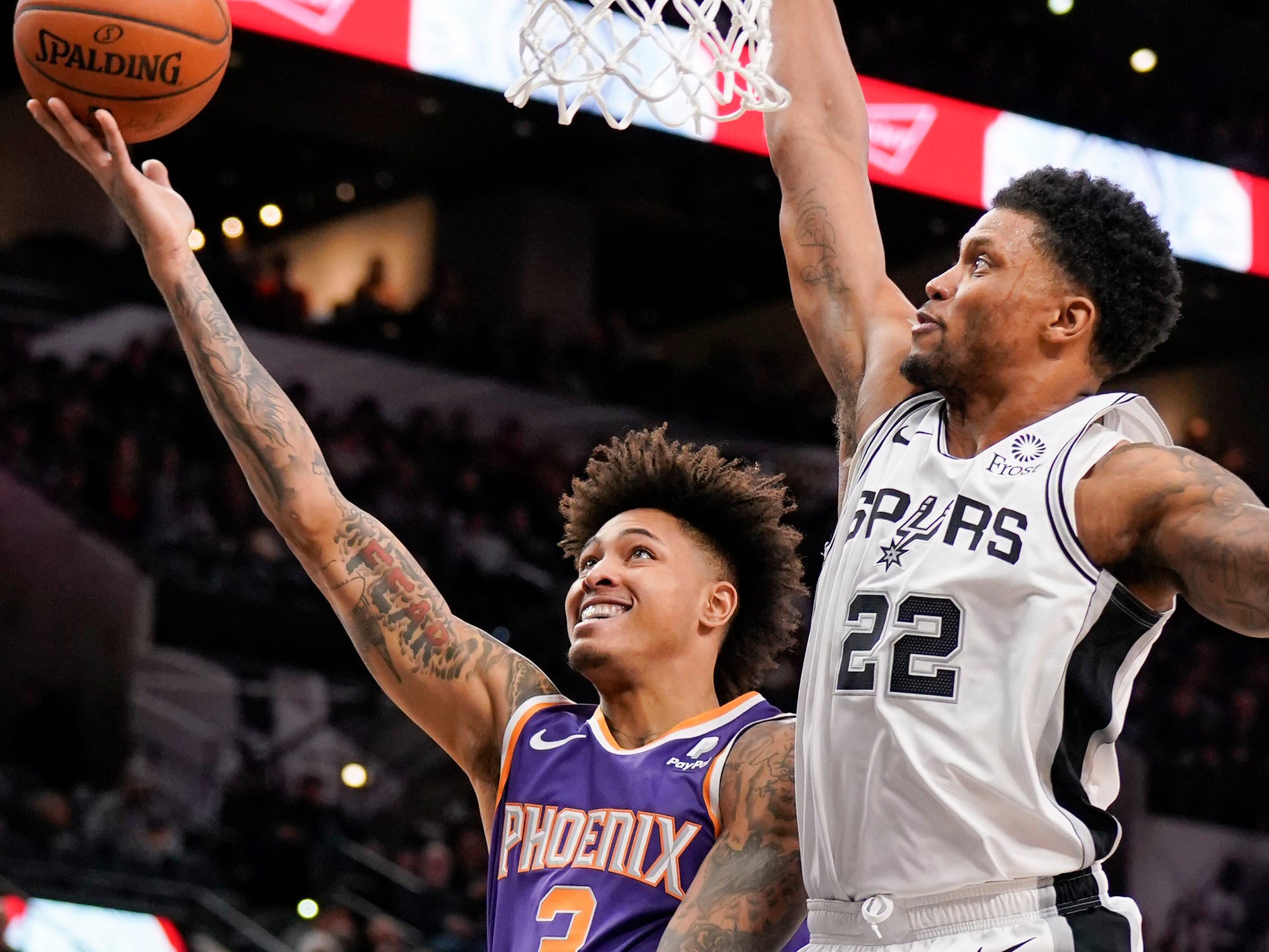 Phoenix Suns' Kelly Oubre, Jr. (3) shoots against San Antonio Spurs' Rudy Gay during the first half of an NBA basketball game, Tuesday, Jan. 29, 2019, in San Antonio. (AP Photo/Darren Abate)