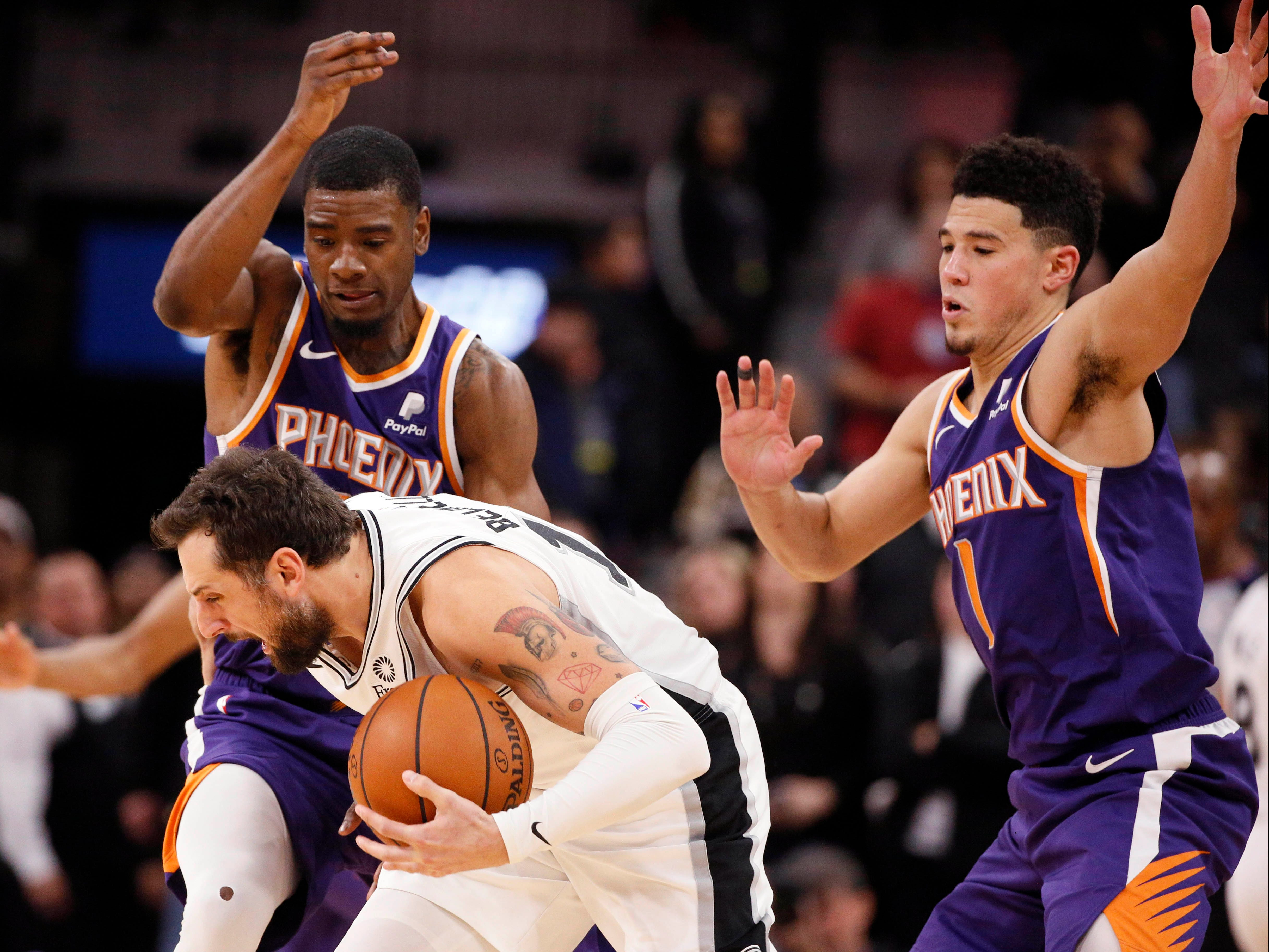 Jan 29, 2019: San Antonio Spurs shooting guard Marco Belinelli (middle) is pressured by Phoenix Suns small forward Josh Jackson (left) and Devin Booker (1) during the second half at AT&T Center.