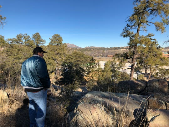 Tim Laskowski, a volunteer with Prescott's Point-In-Time count of homelessness, searches a hiking trail for people without shelter.