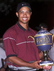 Atone time, American Express was a sponsor of one of the World Golf Championships events. Here Tiger Woods holds the trophy for that event.