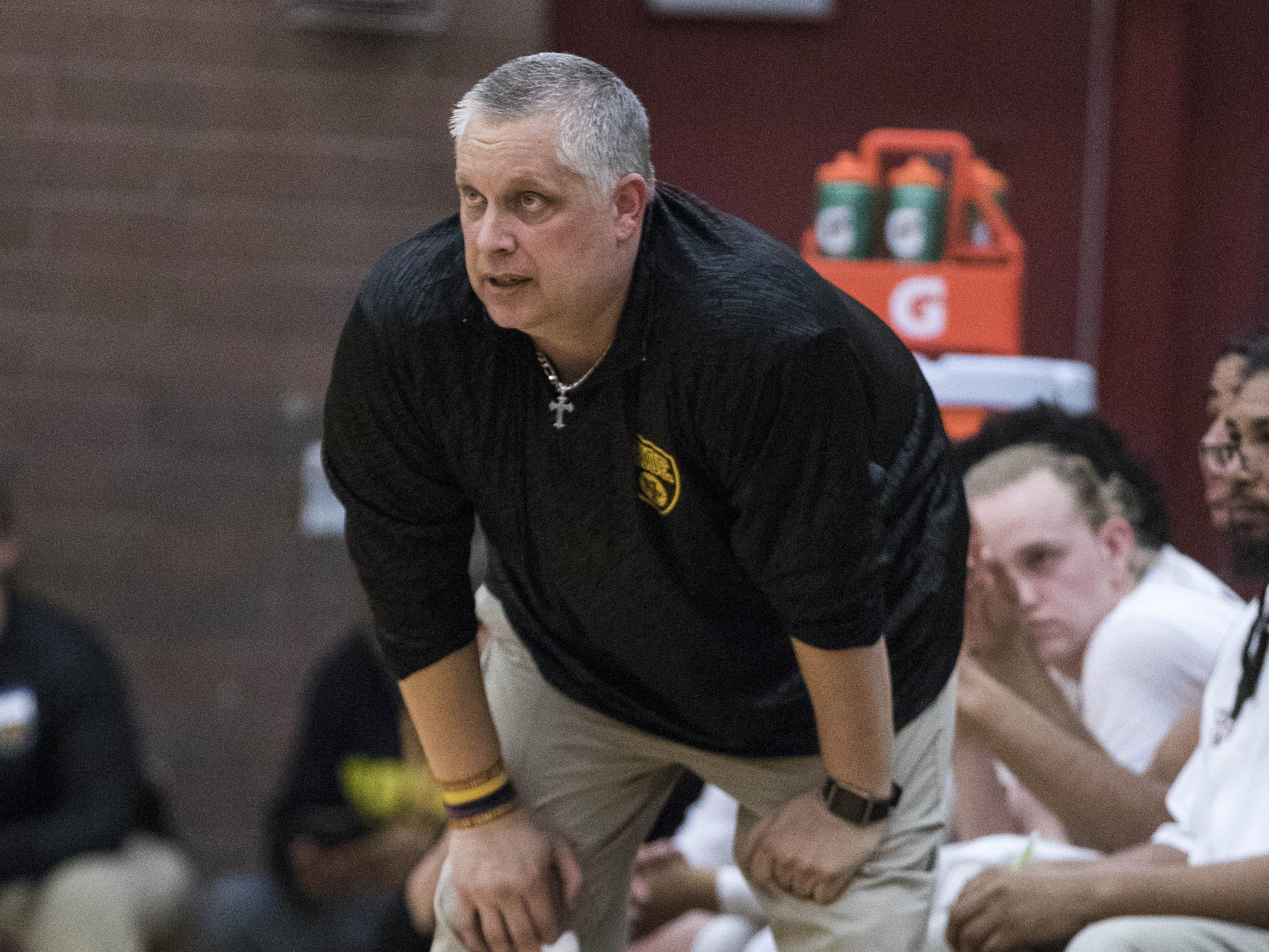 Mountain Pointe coach Kirk FauskeÊwatches his team play defense against Desert Vista's during their game in Phoenix on Tuesday, Jan. 29.