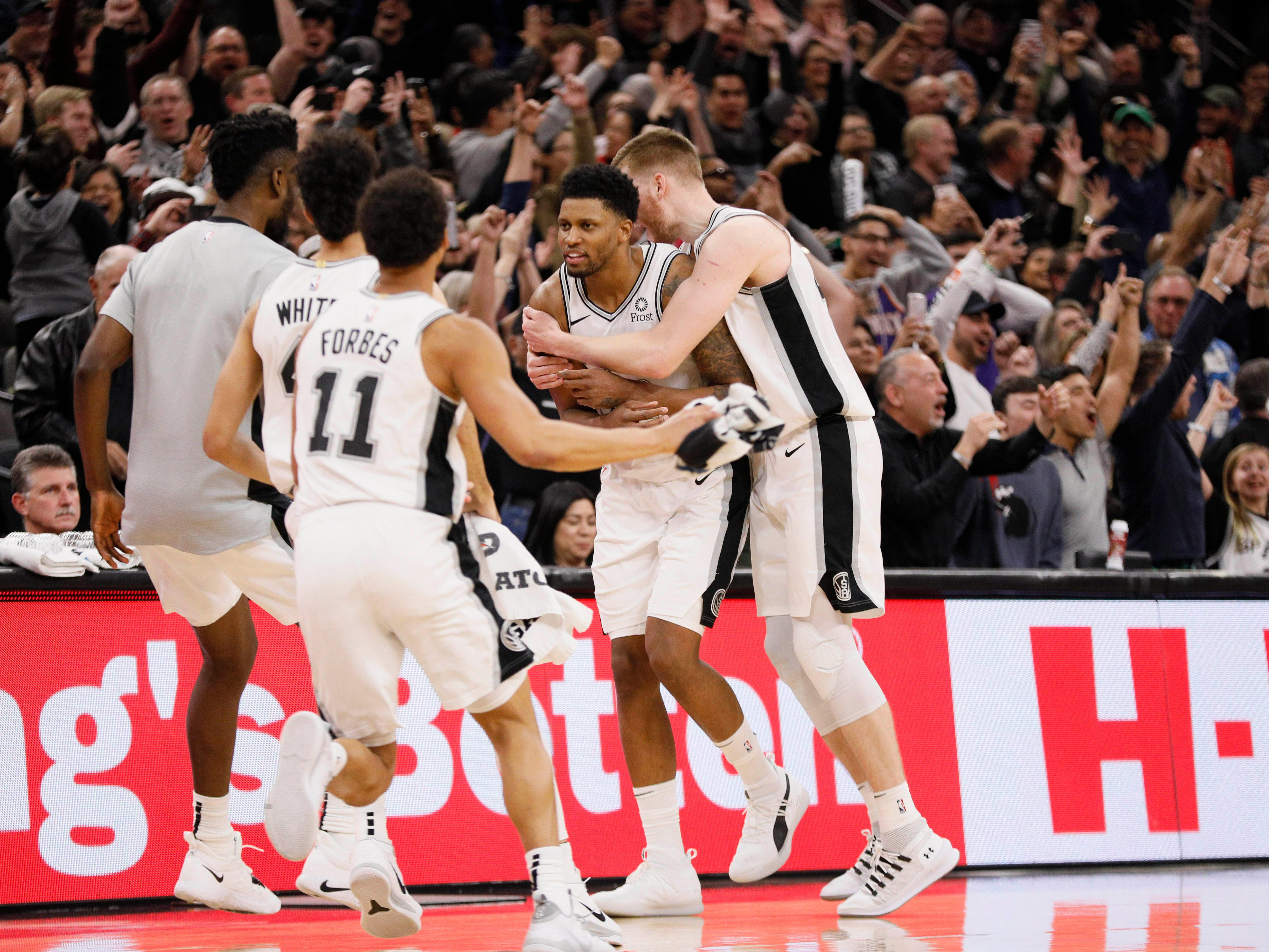 Jan 29, 2019: San Antonio Spurs small forward Rudy Gay (facing camera) celebrates with teammates after scoring at the buzzer during the second half against the Phoenix Suns at AT&T Center.