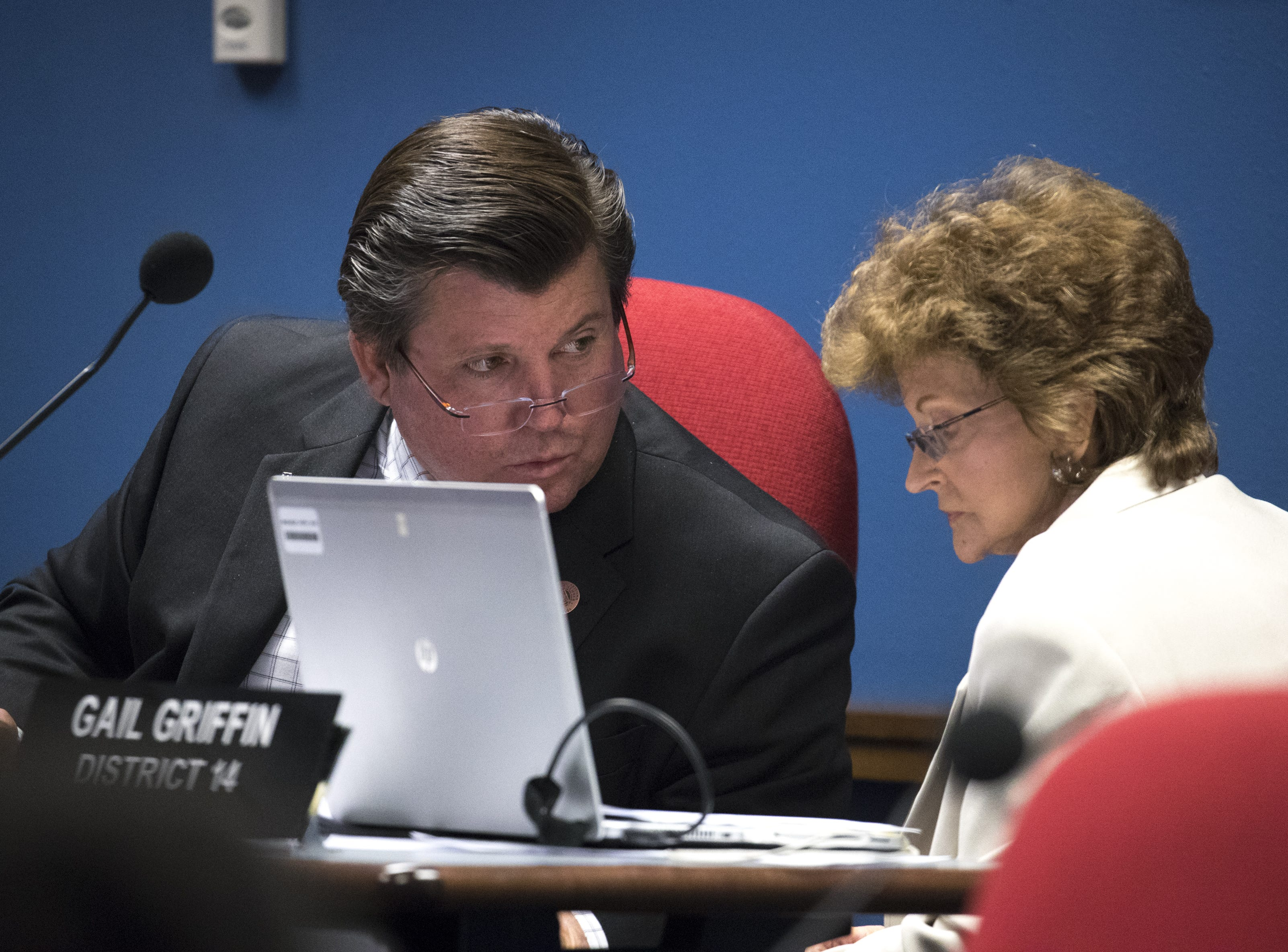 Rep. Timothy M. Dunn (left, vice chairman) talks with Rep. Gail Griffin (chairwoman) during a hearing on HB 2540, Jan. 29, 2019, at the Arizona House of Representatives' Committee on Natural Resources, Energy and Water at the Arizona Capitol.
