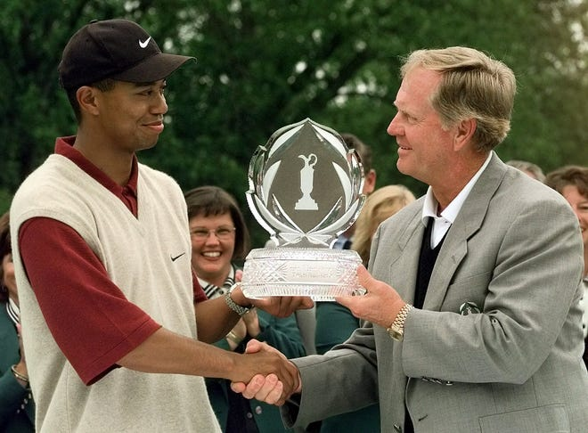 Tiger Woods receives the Memorial Tournament trophy from Jack Nicklaus after Woods finished with a 19-under-par 269. (AP Photo/Jay LaPrete)